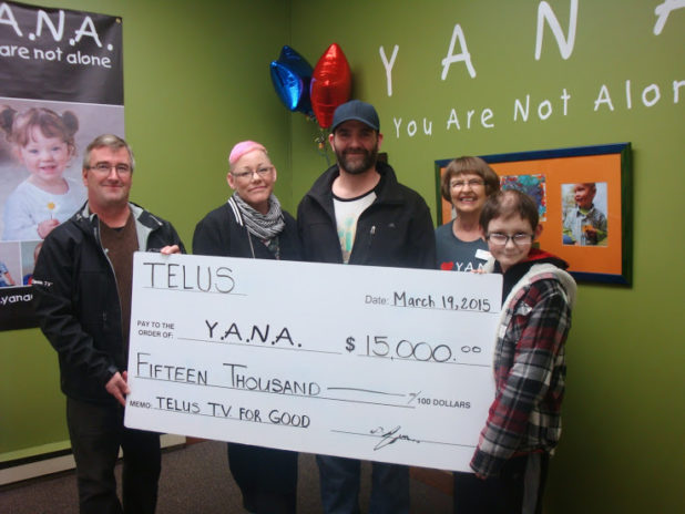 Comox Valley Telus manager Dirk Jezierski presents to Markus Yule on behalf of YANA. Yvonne Yule, Mark Yule, Judy Cryer